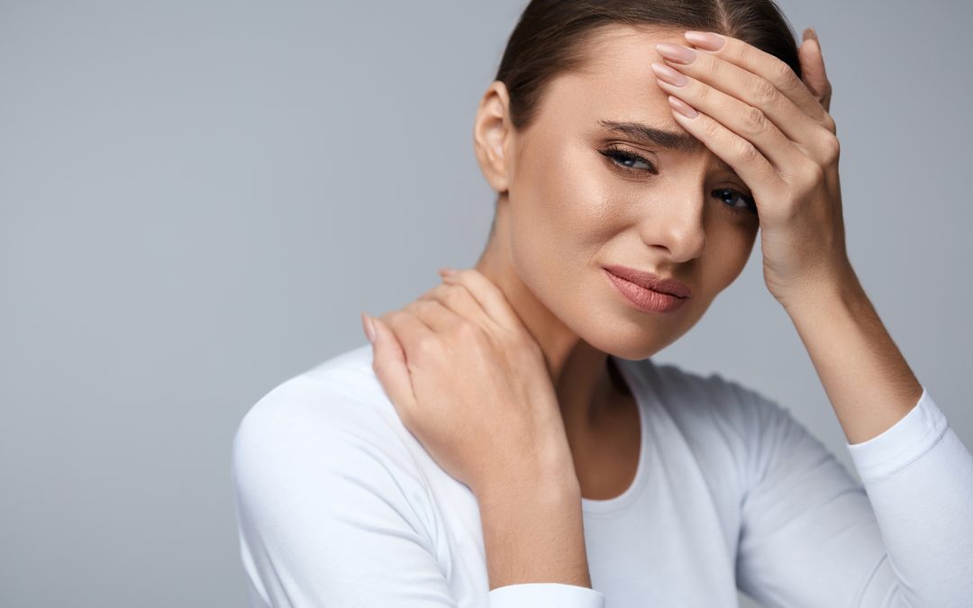 Woman suffering from headache and neck pain